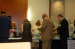 Lyndel Myles, George Wells (brown suit), his fiance to the left, and James Burns at the buffet table.